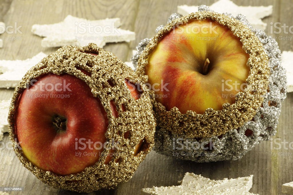 Decorated apples with wooden stars stock photo