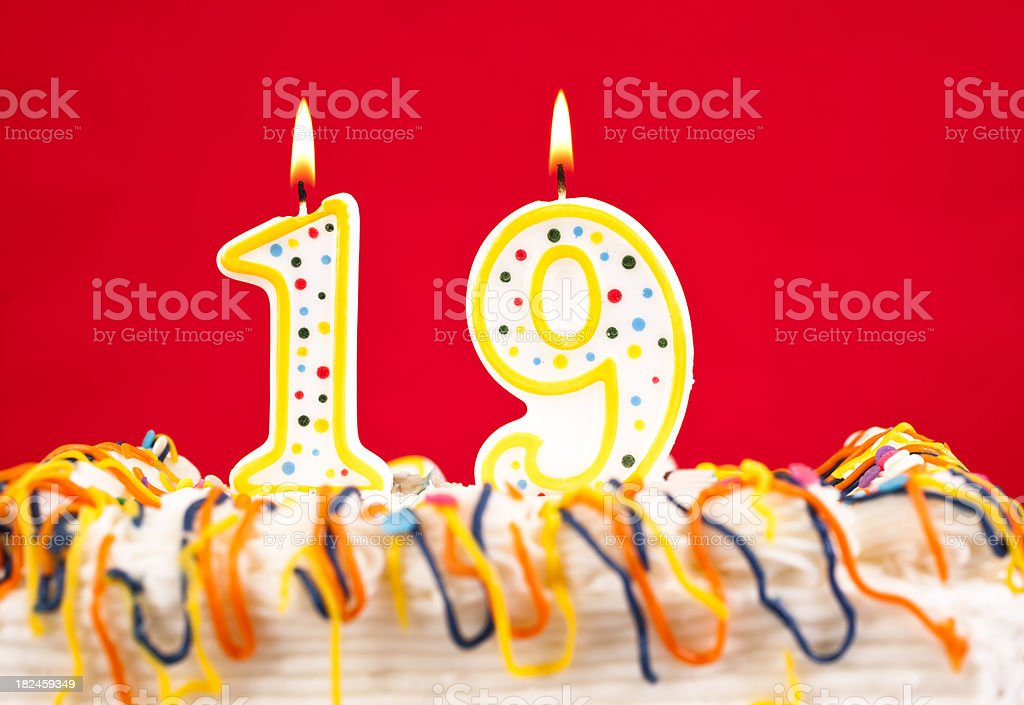 Decorated cake  with number 19 burning candles stock photo