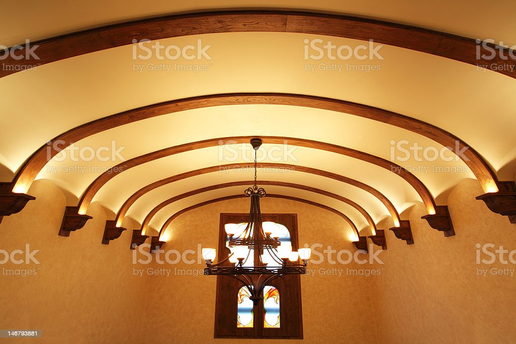 decorated ceiling in warm-toned environment stock photo