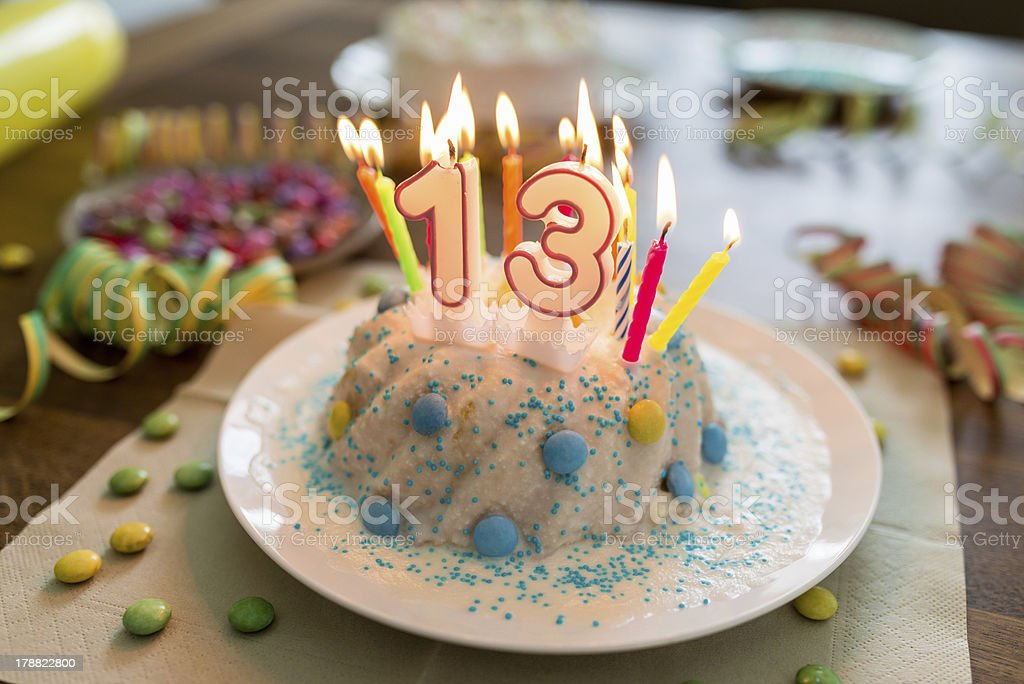 Decorated Child 13th Birthday Cake royalty-free stock photo