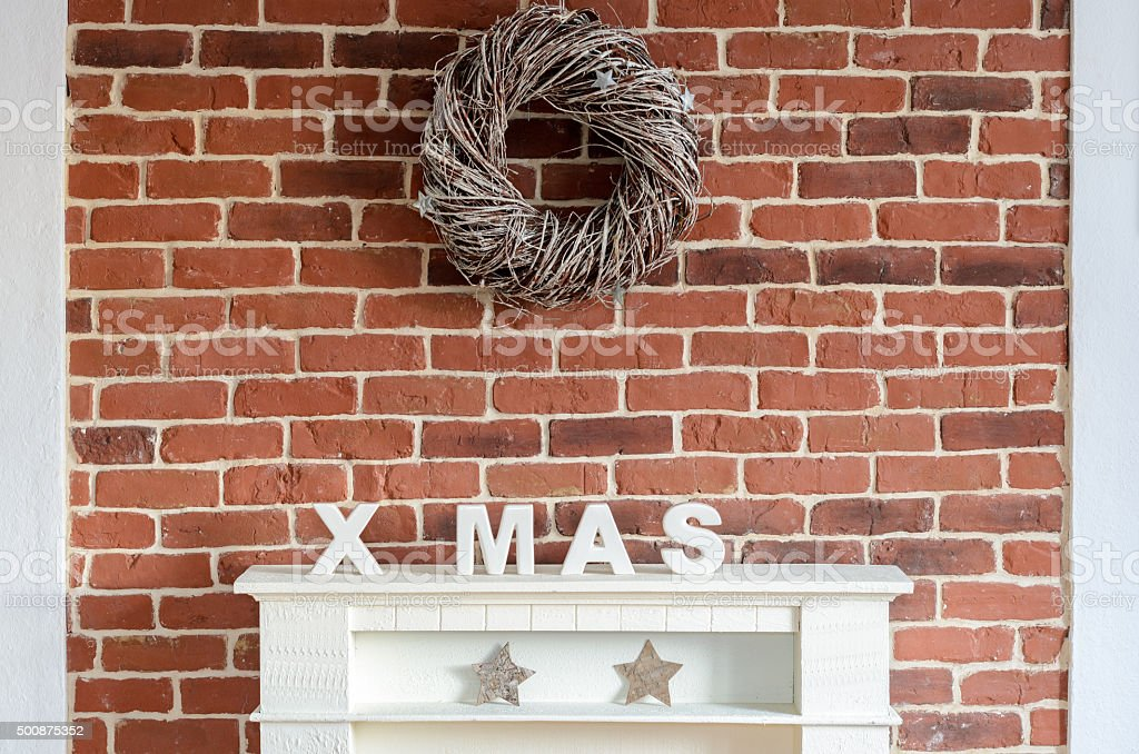 Decorated Christmas fireplace on a brick wall stock photo