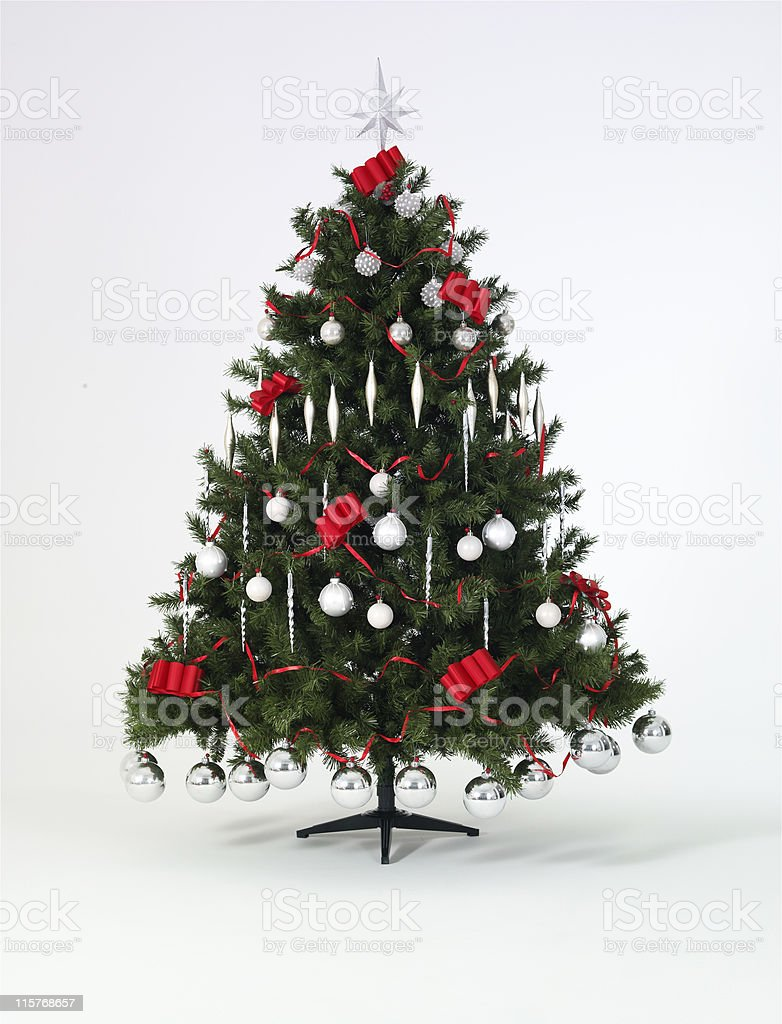 Decorated Christmas tree against a white background royalty-free stock photo
