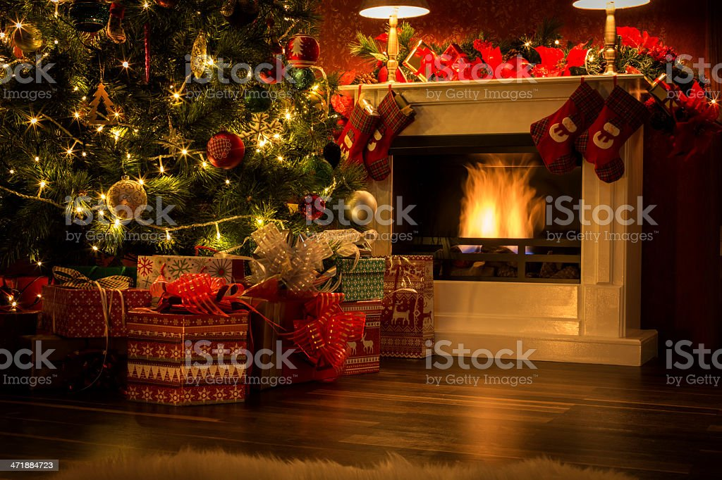 Decorated Christmas Tree with Presents and Fireplace stock photo
