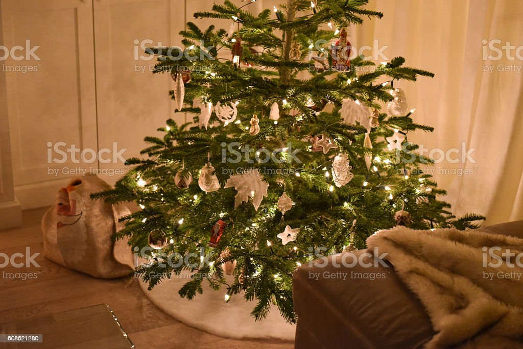 Decorated christmas tree with santa bag under it stock photo