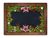 decorated christmas xmas blackboard with fir branches