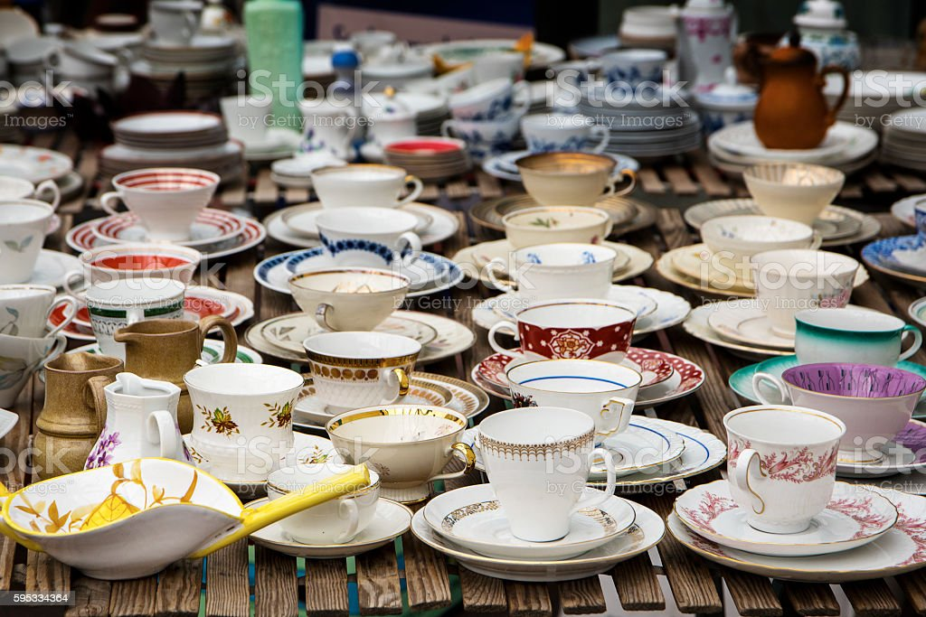 decorated coffee mugs from china porcelain on a flea market stock photo