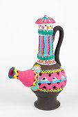 Decorated colorful handcrafted pottery jug