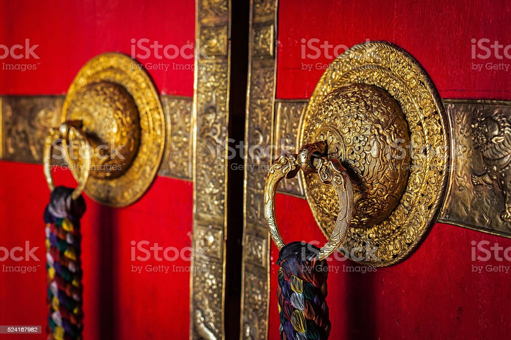 Decorated door handles of Tibetan Buddhist monastery stock photo