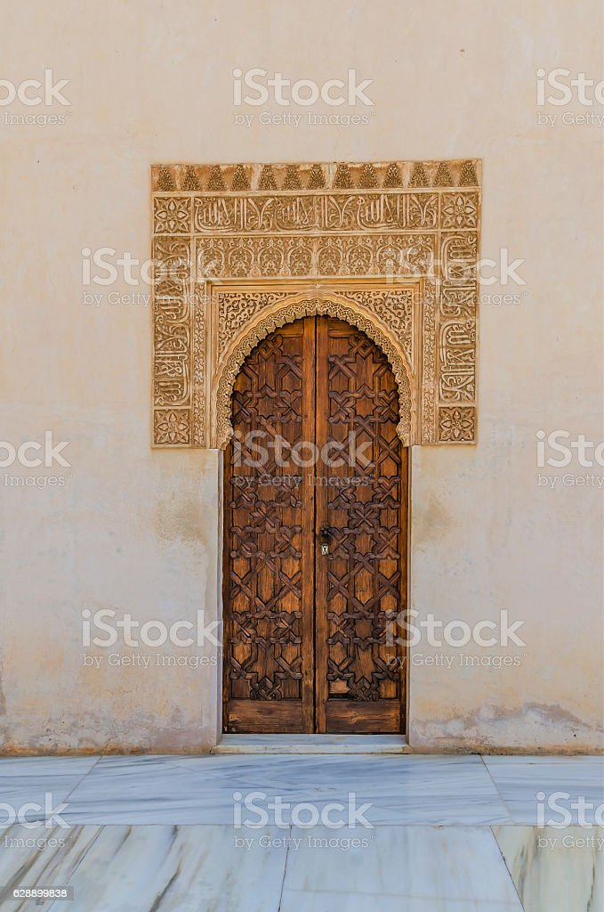 Decorated door with arab ornaments in alhambra stock photo