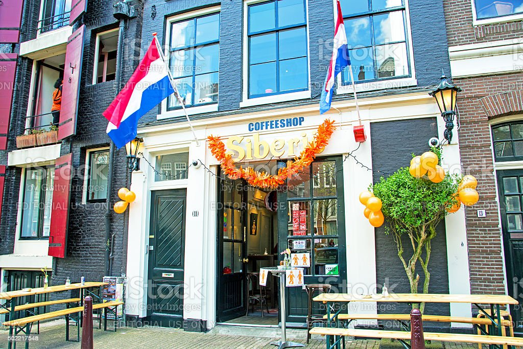 Decorated dutch coffee shop on kings day in Amsterdam Netherlands stock photo