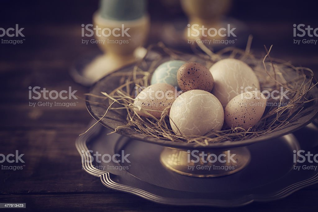 Decorated Easter Eggs in a Bowl in Various Colors stock photo