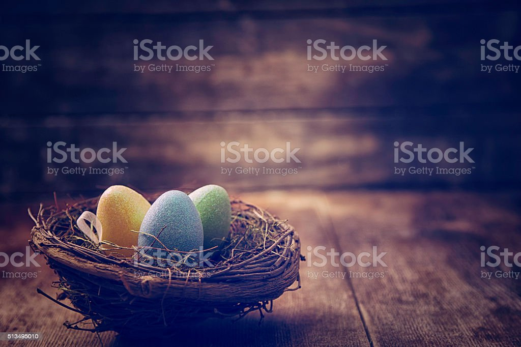 Decorated Easter Eggs in a Nest in Various Colors stock photo