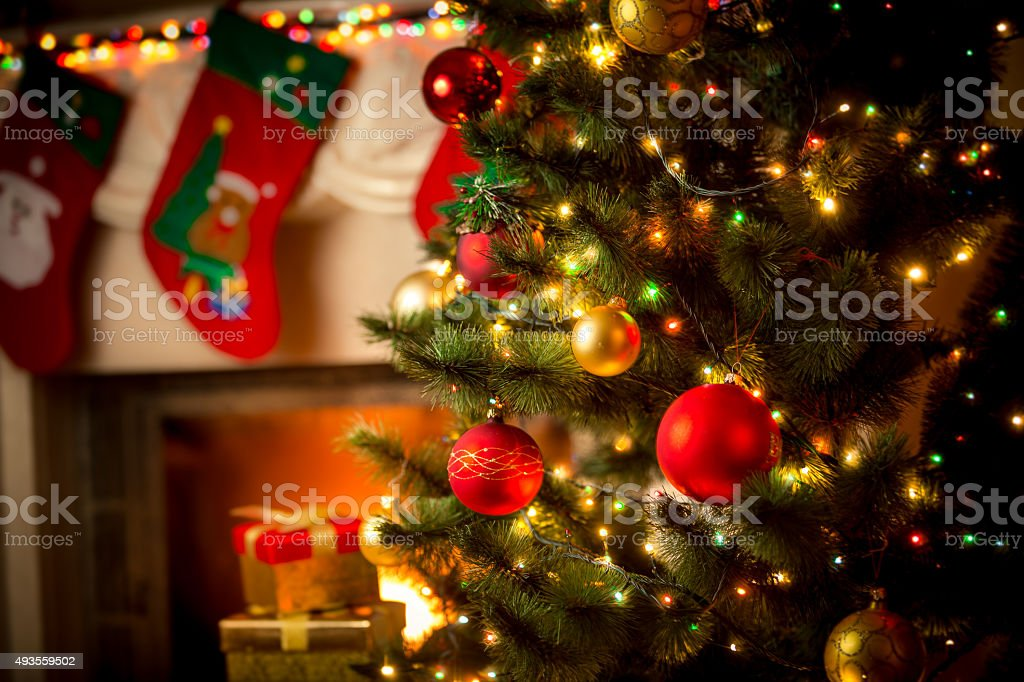 decorated fireplace and Christmas tree at cottage stock photo
