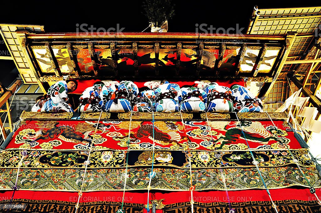 Decorated float with accompanying men in Gion Festival stock photo