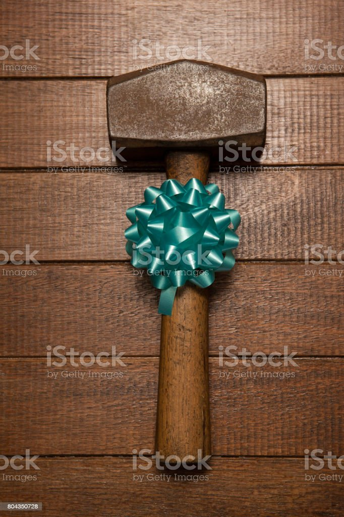 Decorated hammer on wooden plank stock photo