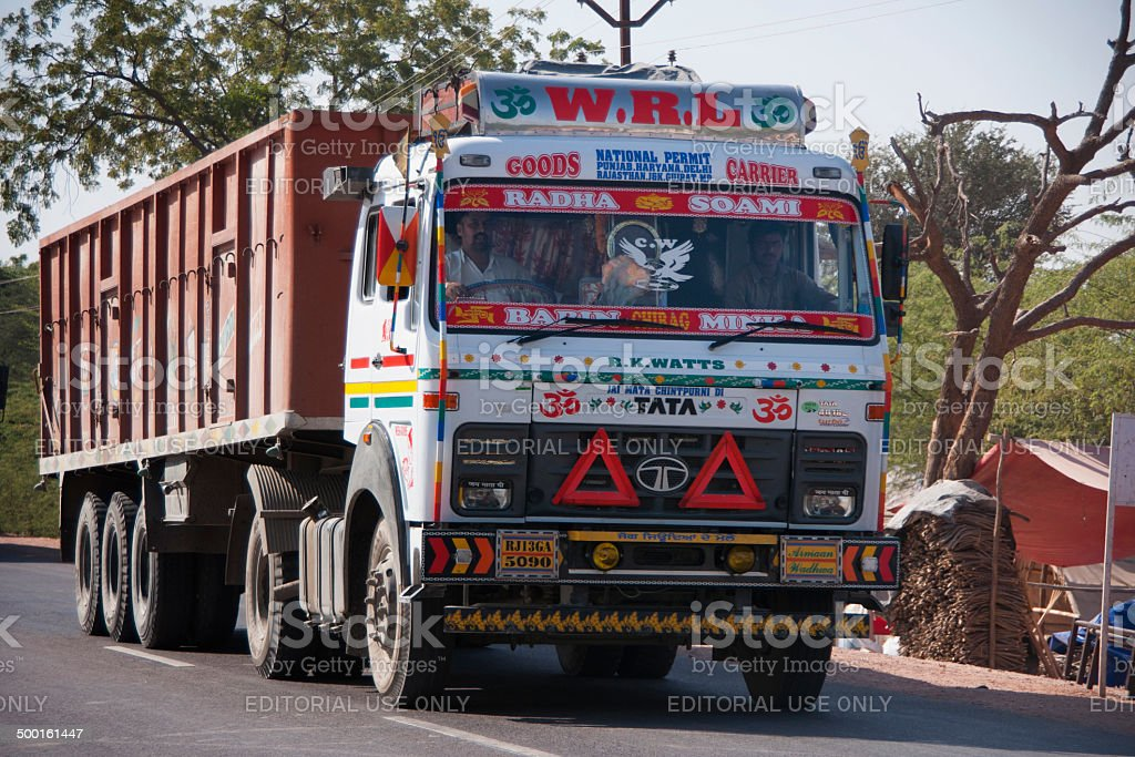 Decorated heavy dump truck on the road in India. stock photo