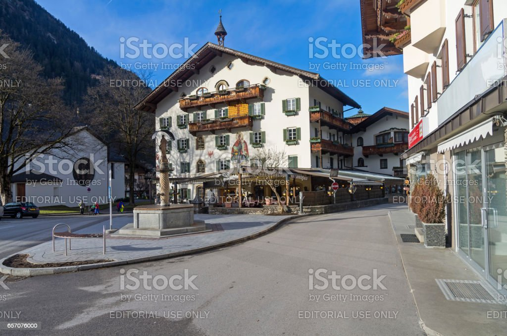 Decorated in the traditional Tyrolean style facade of the hotel. stock photo