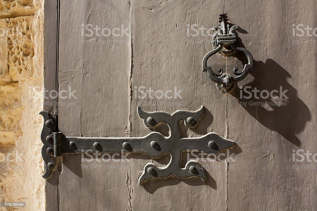 Decorated knocker and hinge. stock photo