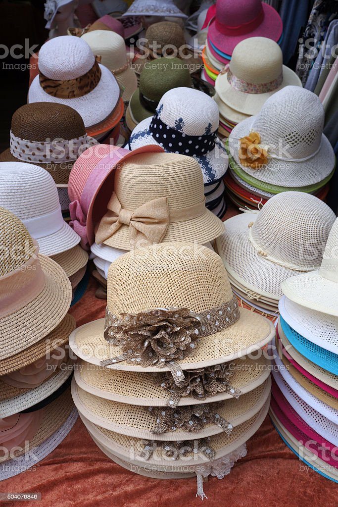 Decorated ladies' hats for sale. stock photo