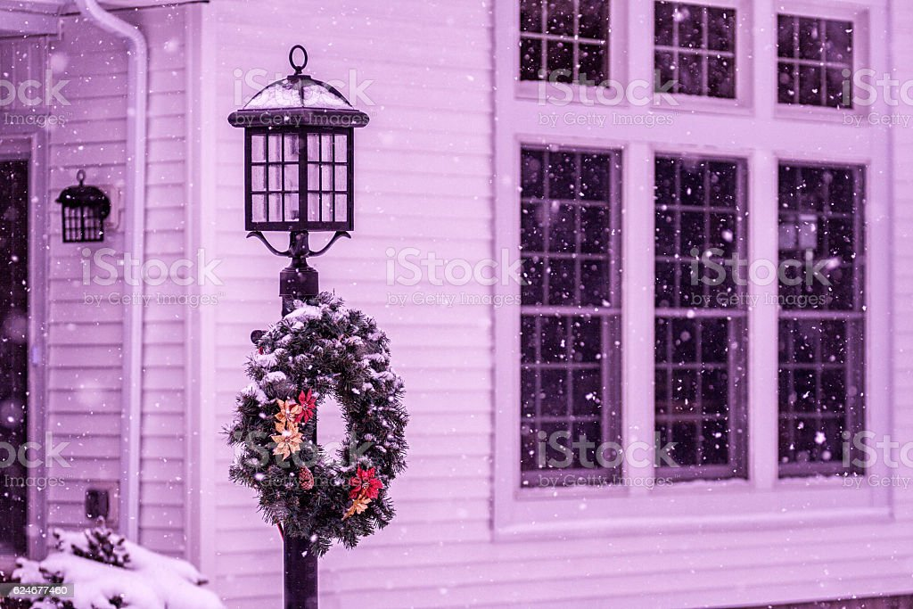 Decorated Pine Needle and Poinsettia Christmas Wreath on Street Lamp stock photo