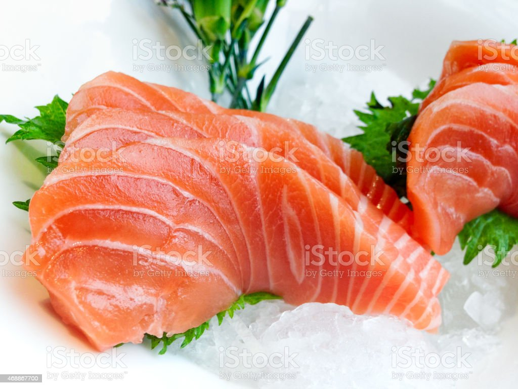 Decorated salmon sashimi on a white plate stock photo