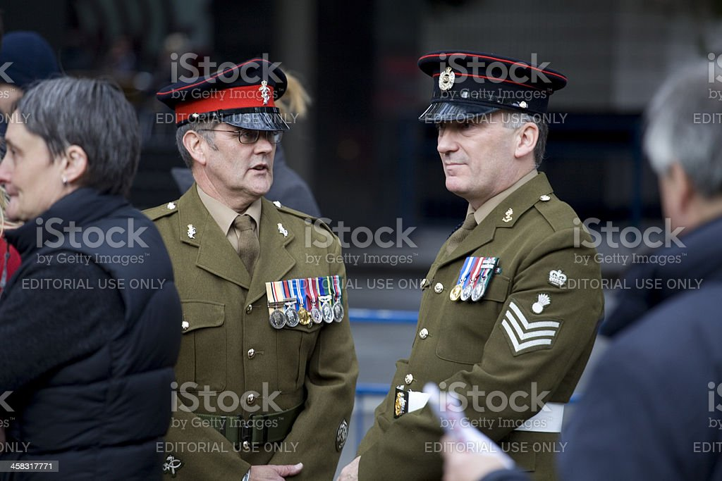 Decorated Soldiers wait for the start of a Remembrance Service stock photo