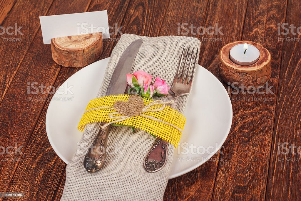 Decorated table for dining in rustic style with pink roses stock photo