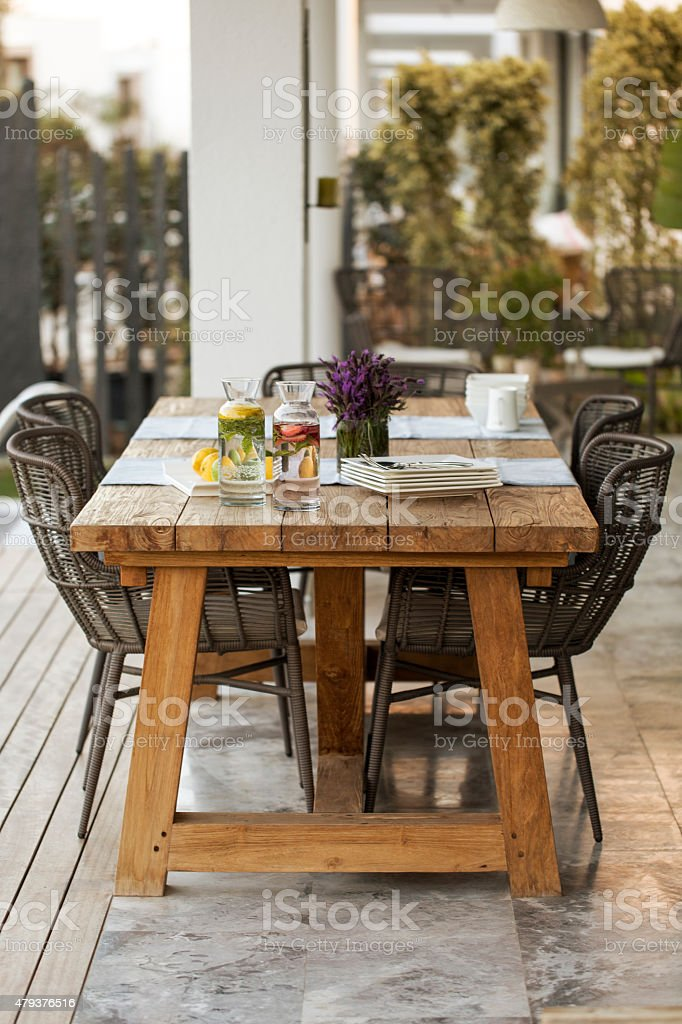 Decorated table in the garden stock photo