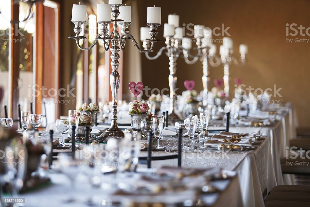 Decorated tables with candelabra at wedding reception, selective stock photo