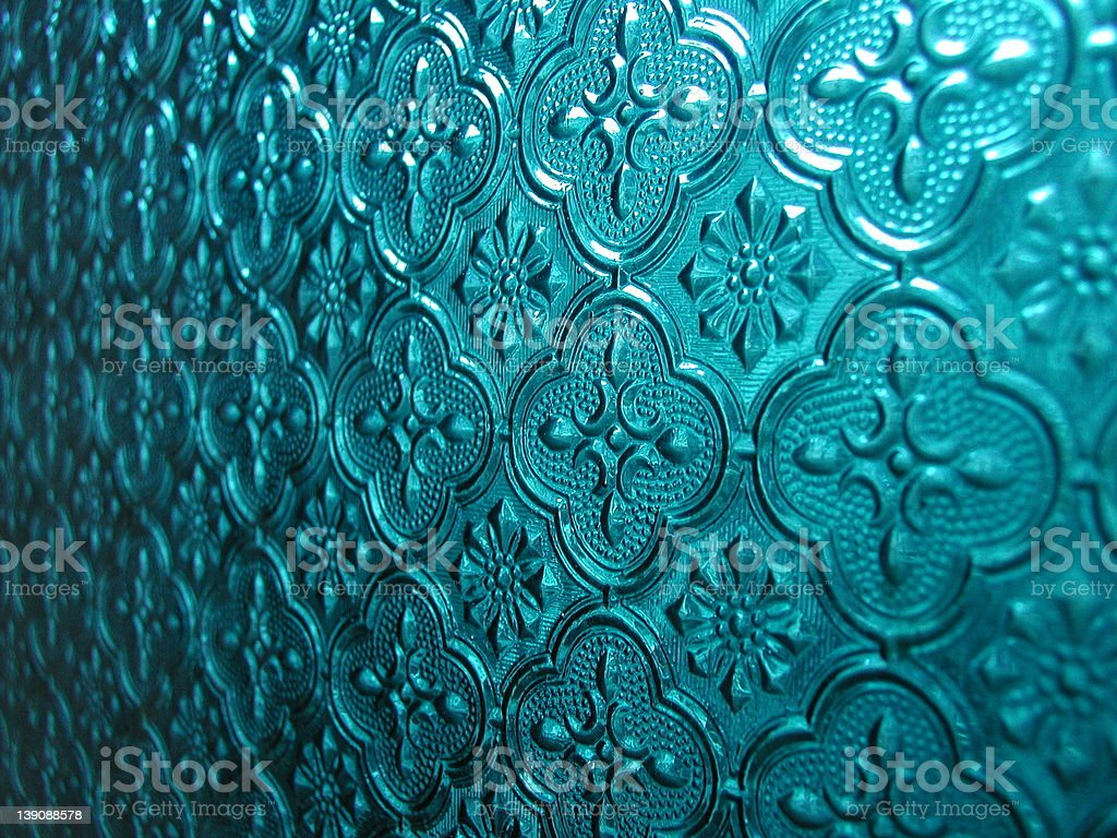 Decorated turquoise window glass royalty-free stock photo