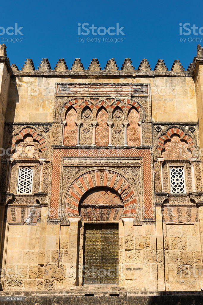 Decorated wall and side entrance to the Mezquita, Cordoba stock photo