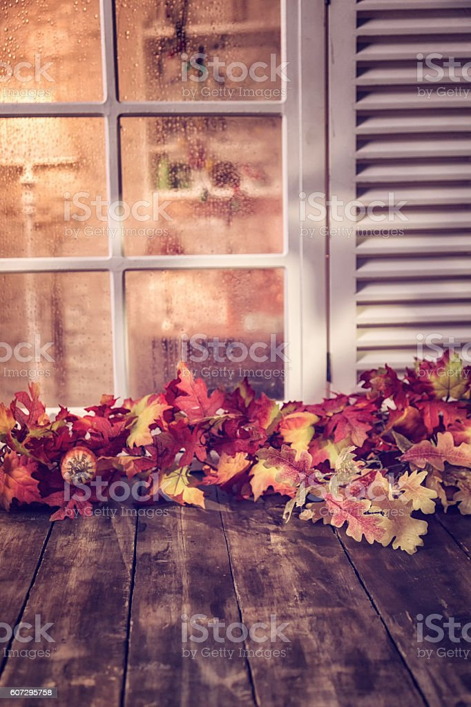 Decorated Window with Autumn Leafs and Pumpkins stock photo