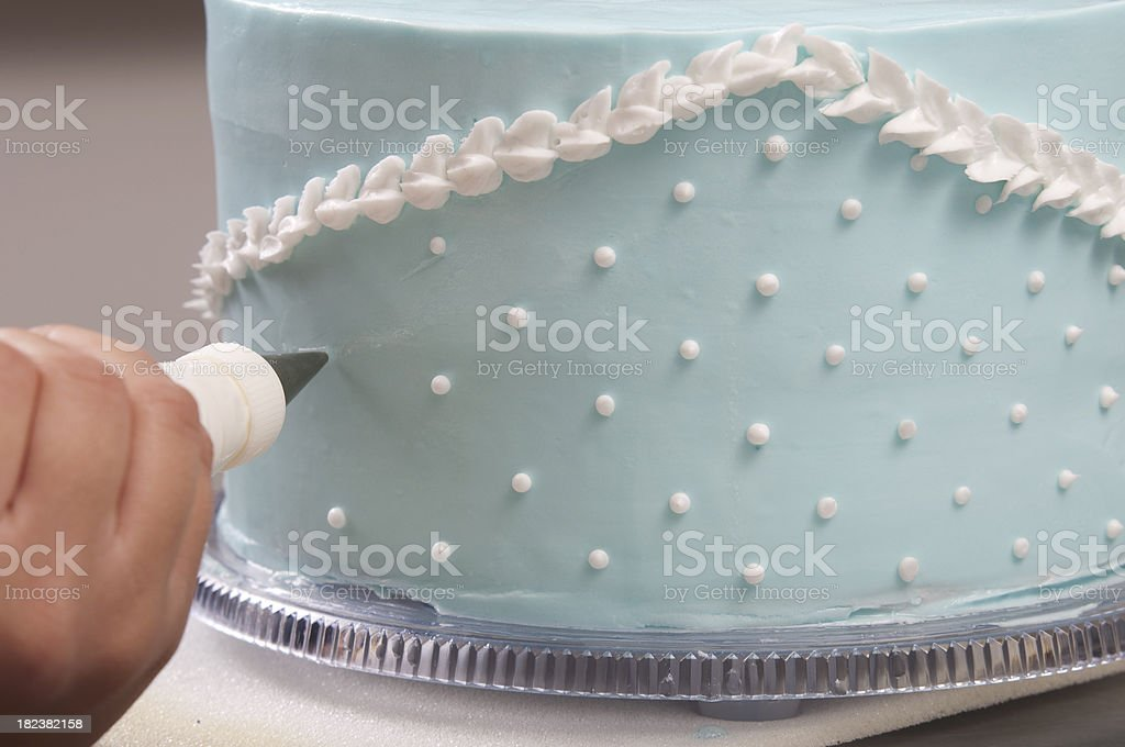 Decorating a blue wedding cake stock photo