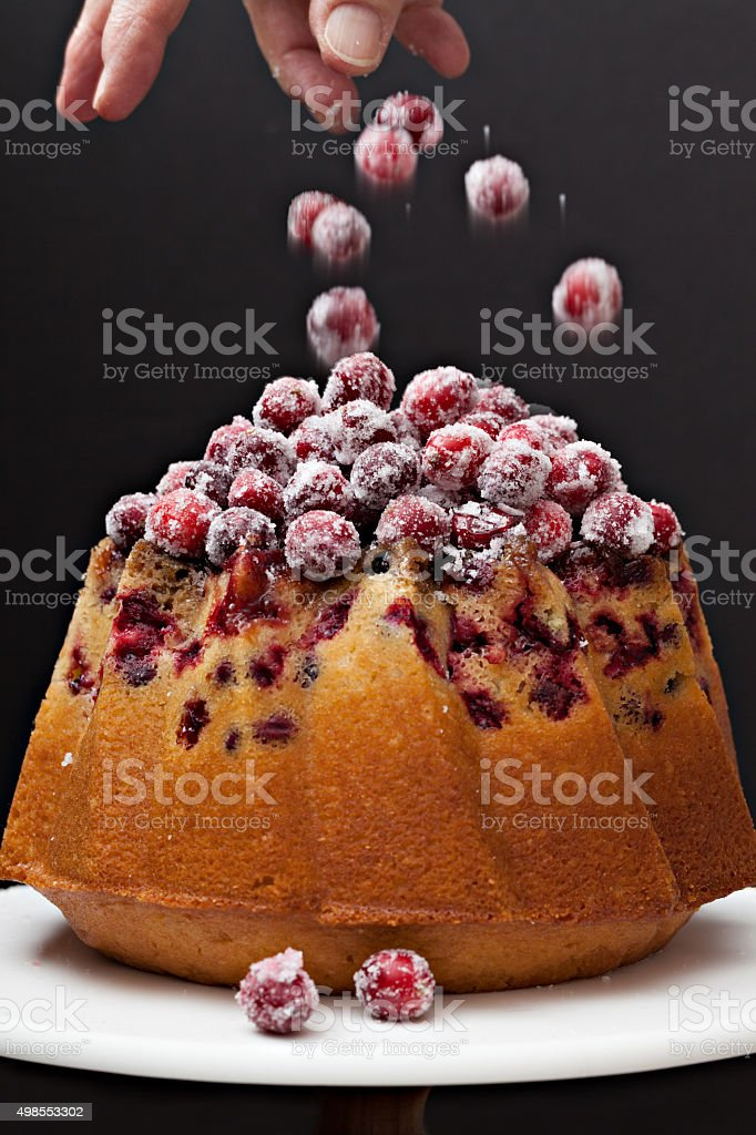 Decorating A Christmas Cranberry Cake stock photo