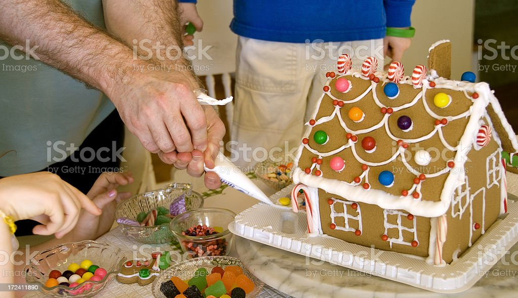 Decorating a Christmas Gingerbread House royalty-free stock photo