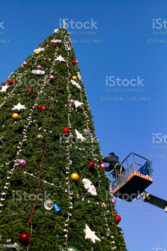 Decorating a Christmas tree stock photo