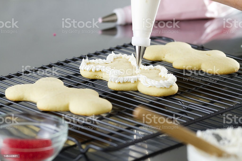 Decorating a Cookie with Frosting royalty-free stock photo
