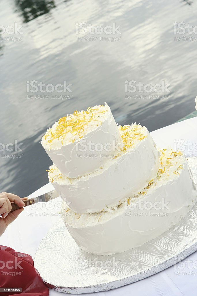 Decorating a Wedding Cake royalty-free stock photo