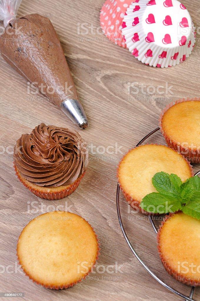 Decorating Chocolate Cupcakes stock photo