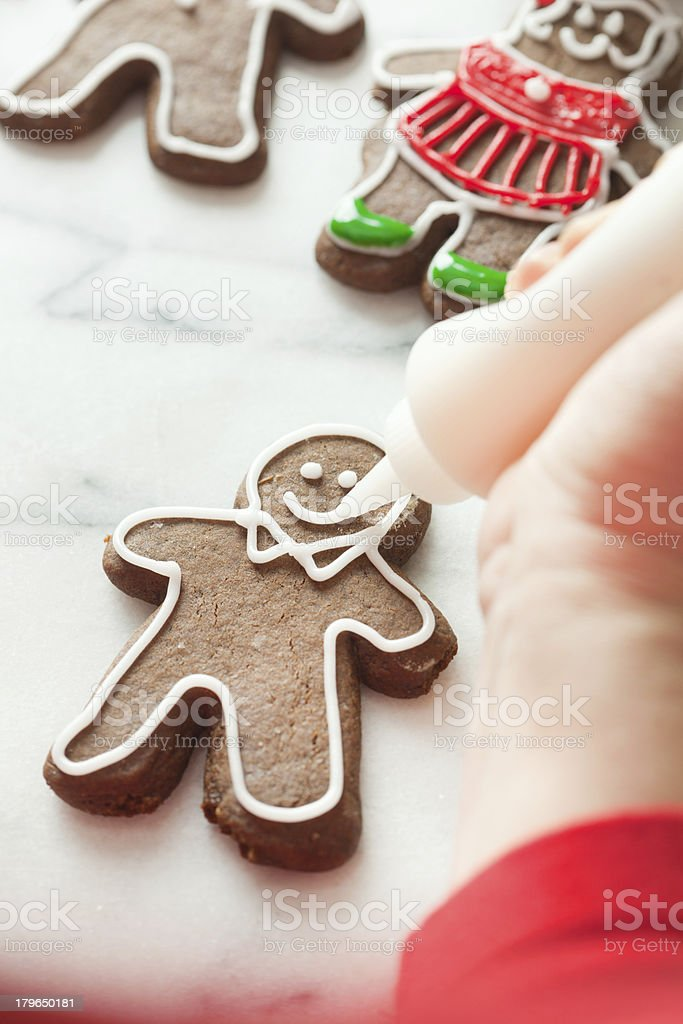 Decorating Christmas Gingerbread Cookies with Frosting Vt royalty-free stock photo