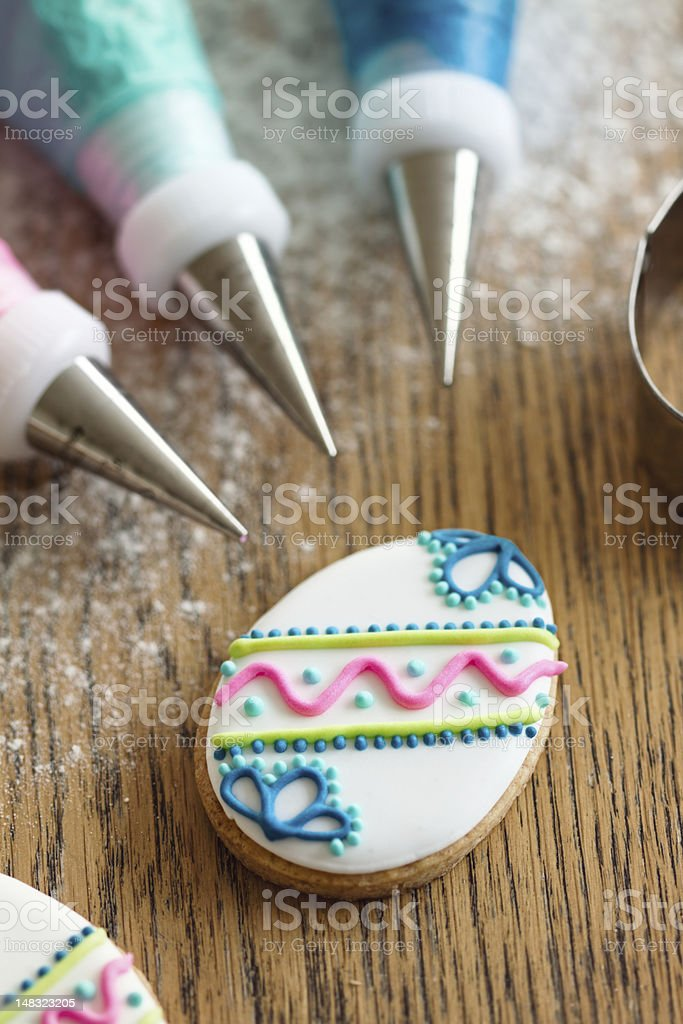 Decorating Easter cookies stock photo