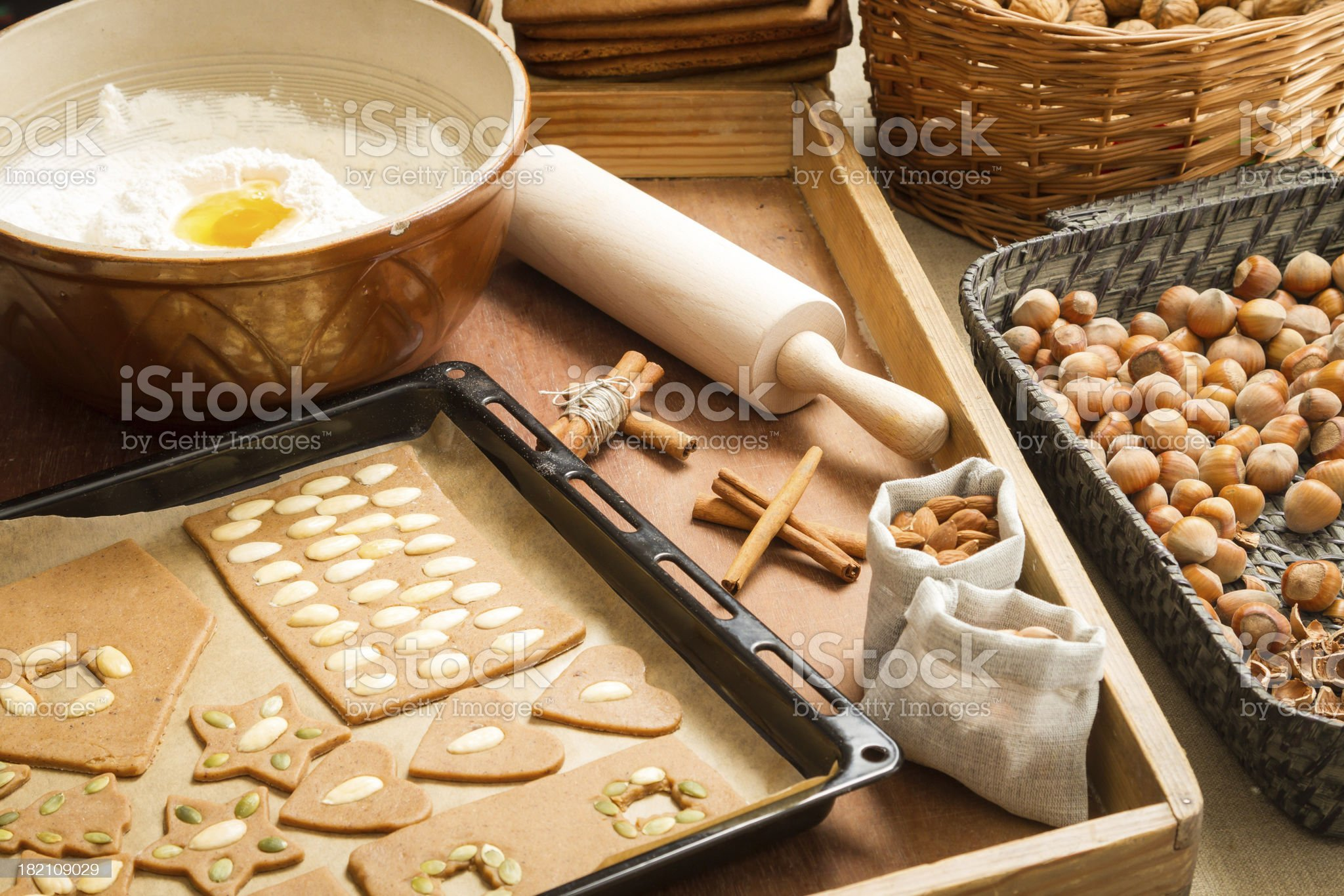 Decorating gingerbread cookies nuts just before baking royalty-free stock photo