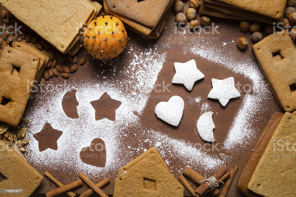 Decorating gingerbread cookies with icing sugar royalty-free stock photo
