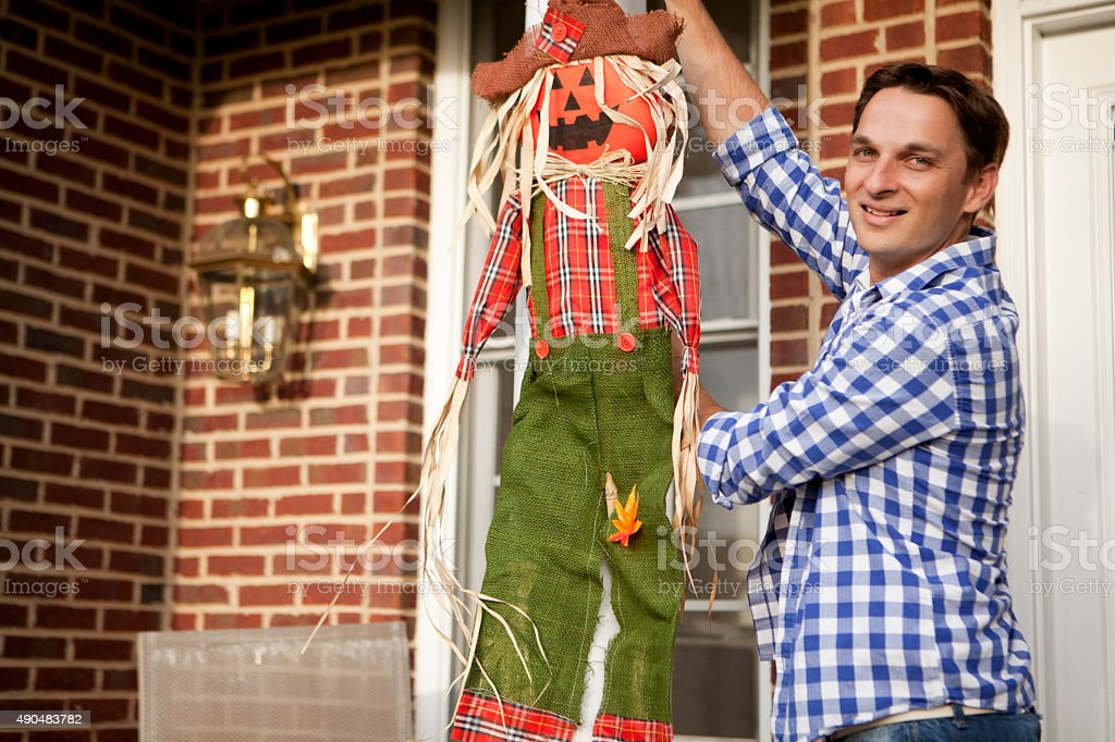 Decorating house for Halloween stock photo