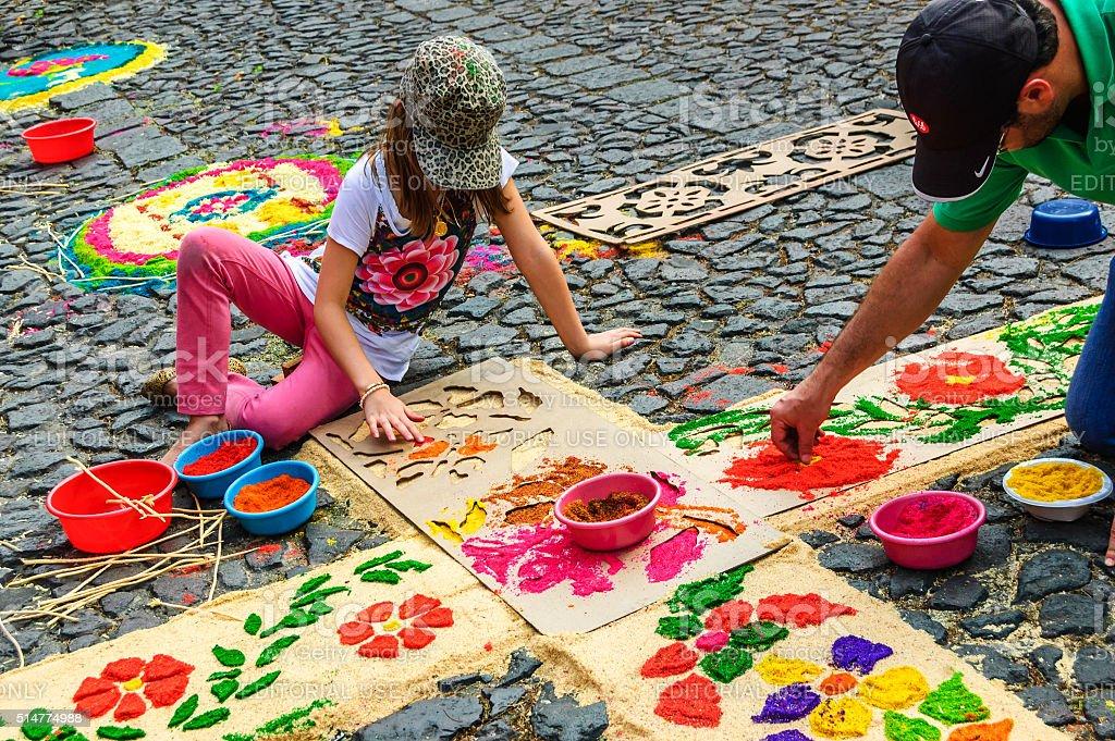 Decorating Lent carpet with dyed sawdust, Antigua, Guatemala stock photo
