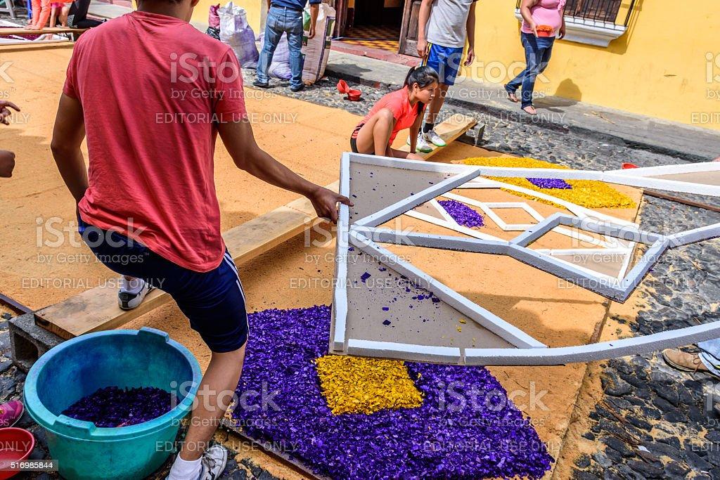 Decorating Palm Sunday carpet with dyed sawdust, Antigua, Guatem stock photo