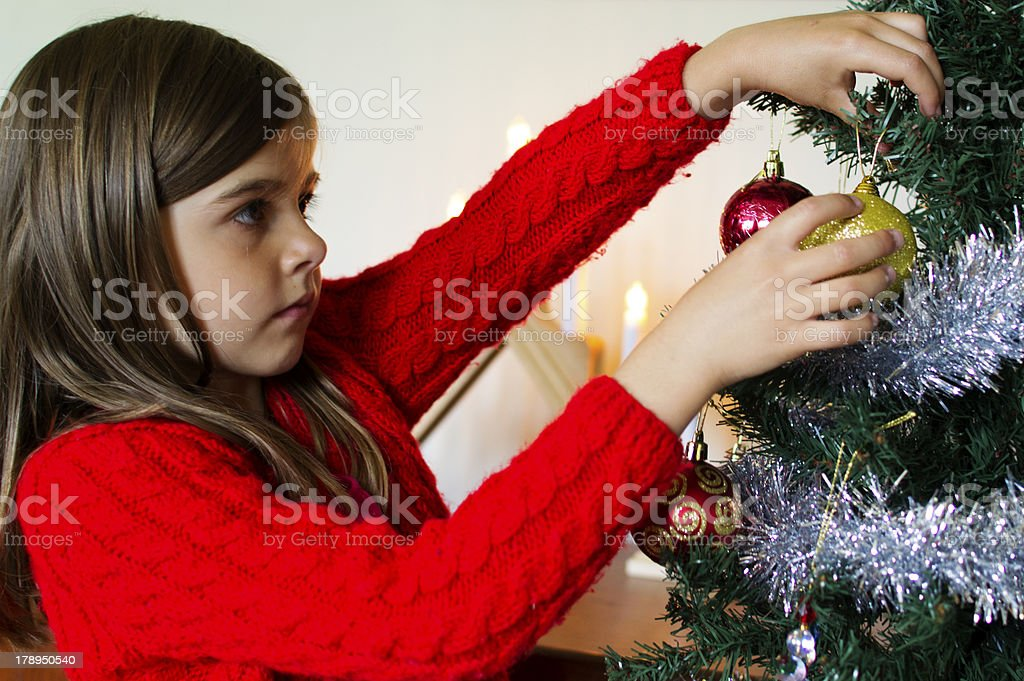 Decorating the Christmas tree royalty-free stock photo