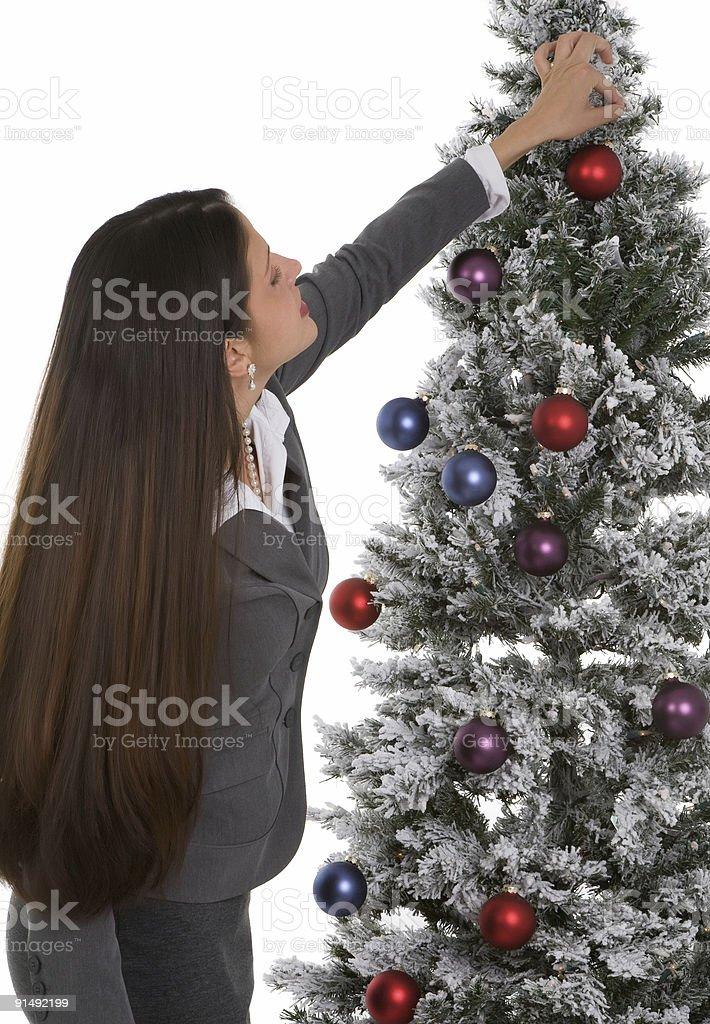 Decorating the Tree royalty-free stock photo