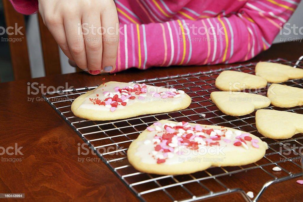 Decorating Valentine's Cookies royalty-free stock photo