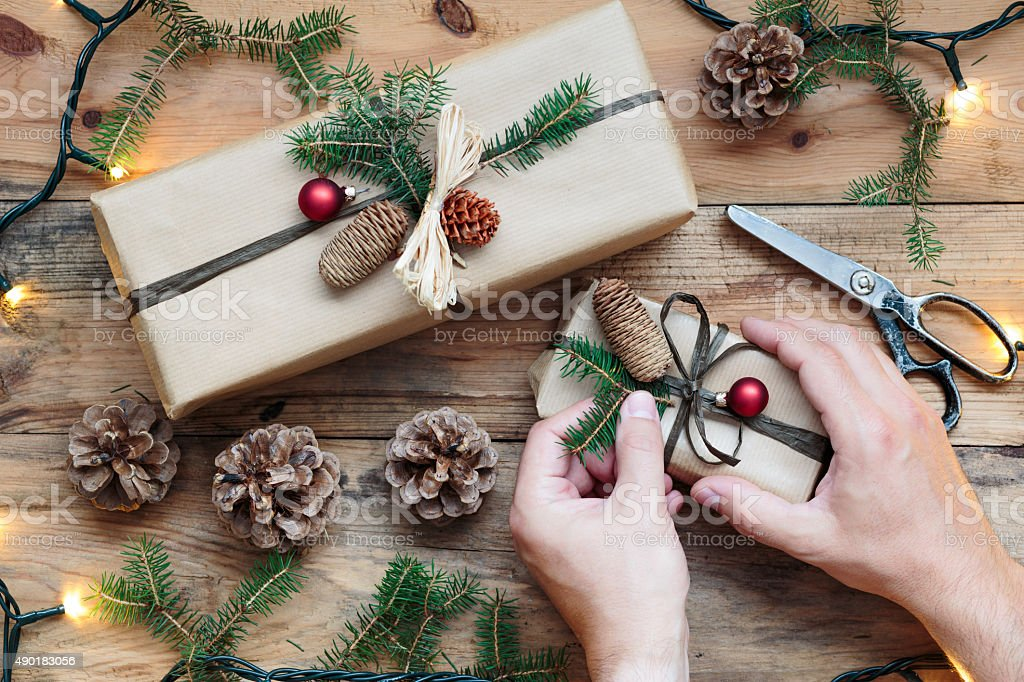 Decorating wrapped Christmas presents stock photo